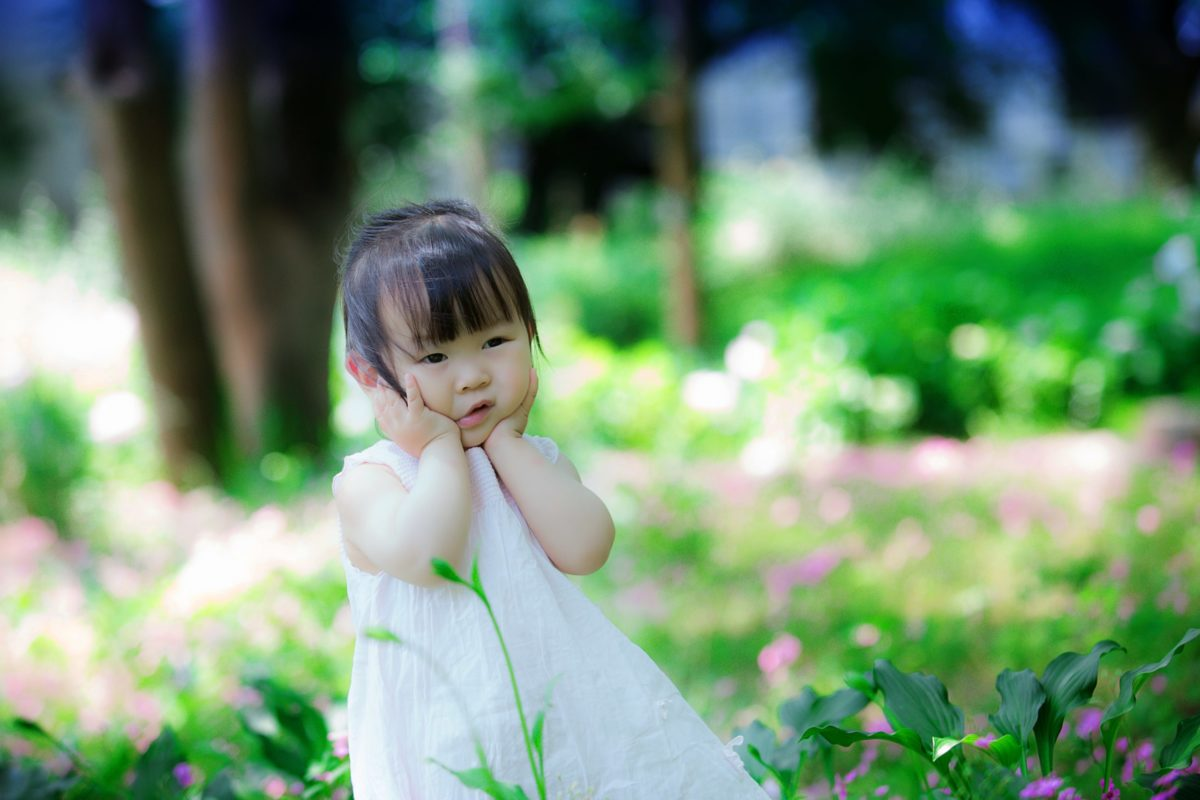 little girl in a garden waiting for deed poll