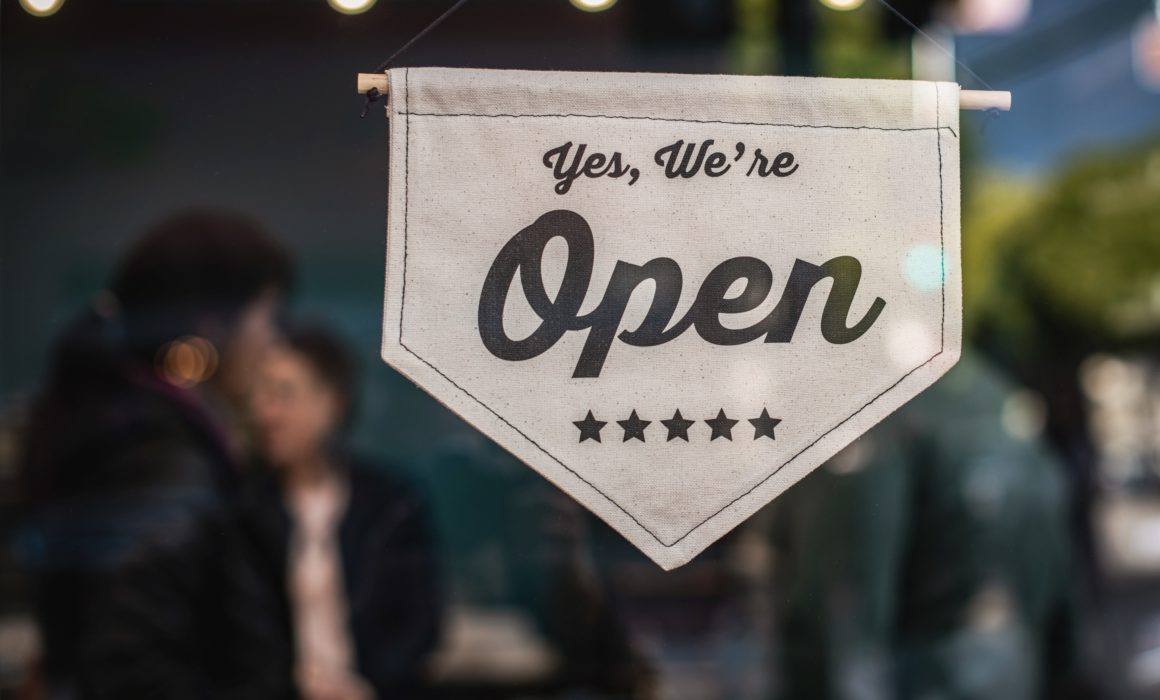 open signage on a family business with a succession plan